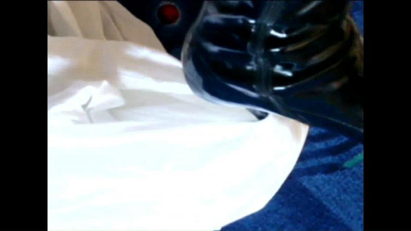 Jana tramples and destroys her friends white shirt with her black patent high heel stiletto boots close up