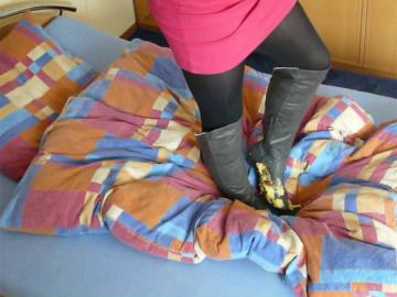 Jana trample on bed with her grey Graceland heel overknee boots and messy both