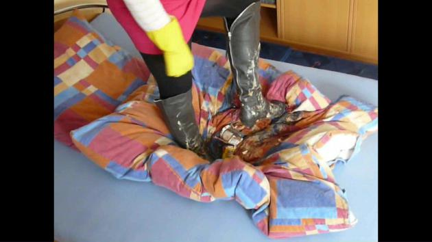 Jana tramples with her gray Graceland heel over knee boots on her bed and messes up both