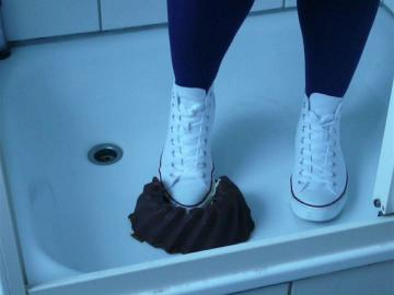 Jana crush with her white chuck converse hi a cake, then messy, fill, trample on and wash them