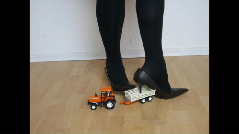 Jana fill her high heel pumps with banana and crush a toy tractor with it