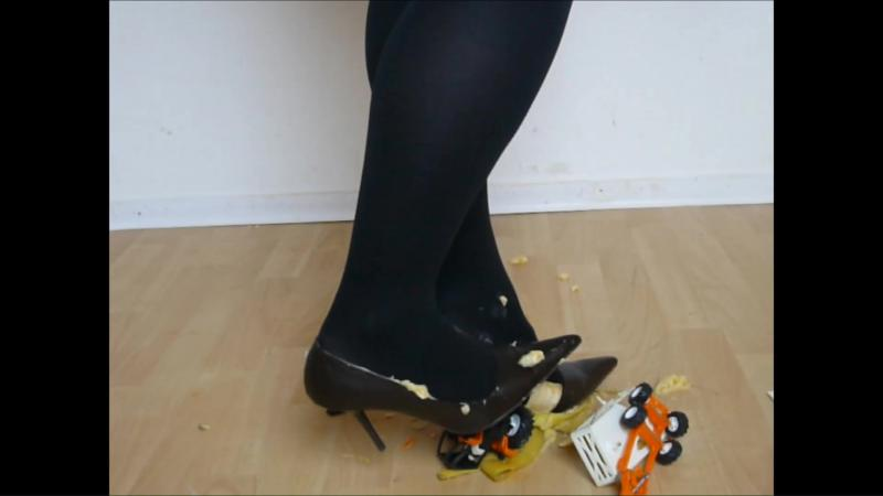 Jana fills her stiletto pumps with banana and destroys a toy tractor