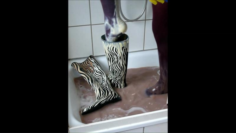 Jana write on her Zebra rubber boots, fill and messy them in the shower