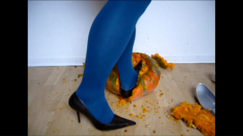Jana crushes a pumpkin with her brown stiletto pumps and silver ballerinas