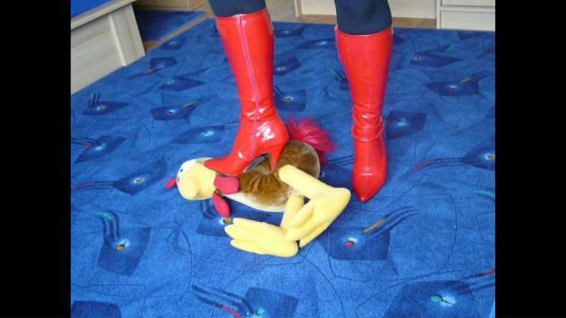 Jana shreds a fabric chicken with her red stiletto patent boots