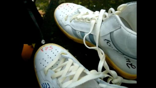Jana writes, spits and trample on her Adidas Trophy sneakers