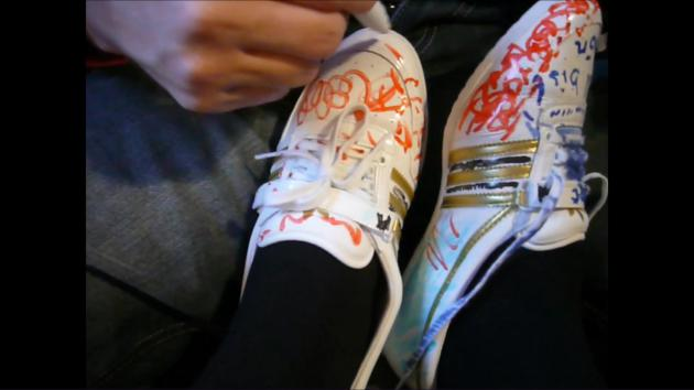 Jana´s friend write on and paints her Adidas Concord Round Ballerinas white patent on her feet