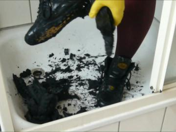 Jana cleans and kill her shiny black Buffalo boots in the shower