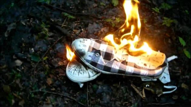 Jana´s friend cuts her black and white canvas shoes and burns them