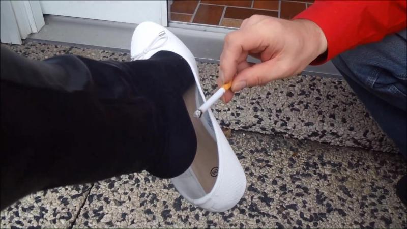 Jana´s friend uses her white ballerinas as an ashtray on her feet and burns them