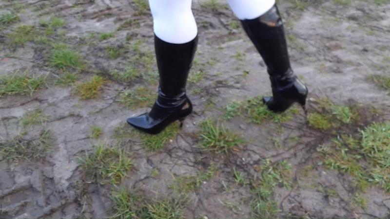 Jana tramples on her patent jacket with patent leather boots in the mud and breaks off her heels