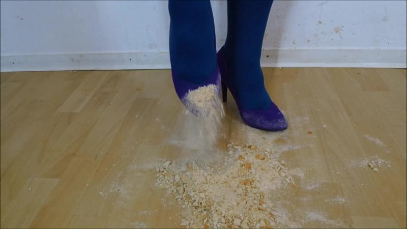 Jana crush bread rolls and baguette with her velvet lilac high heel Pumps