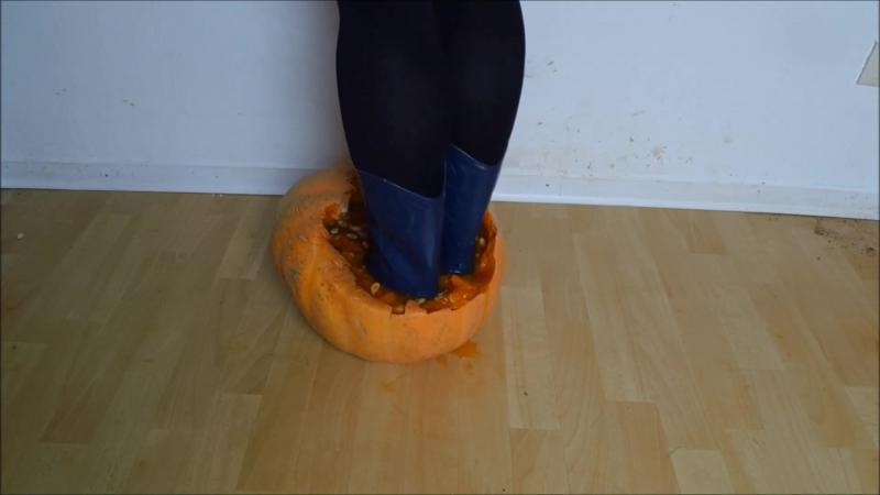Jana crush a pumpkin with her blue cowgirl rubber boots