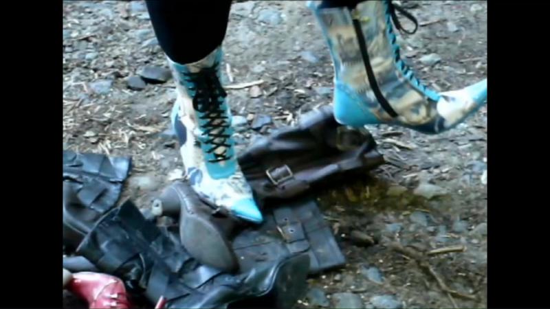 Jana tramples and destroys other boots with some of her stiletto ankle boots