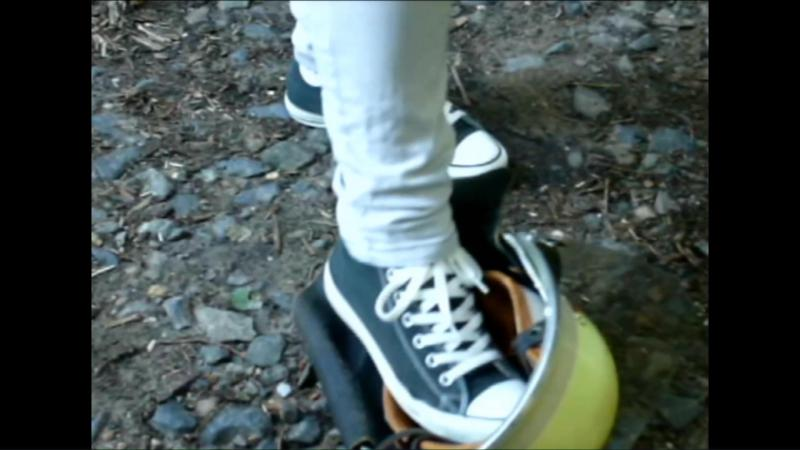 Jana tramples on a fire helmet and crushes it with her black chucks