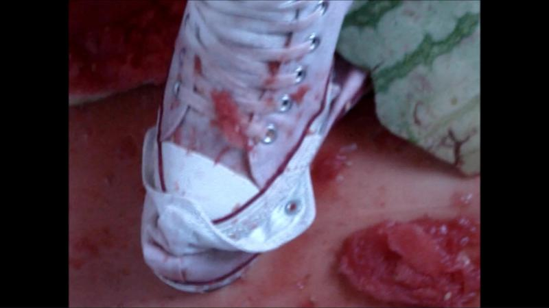Jana crushes a watermelon with her white Converse Chucks and messy them with it close up