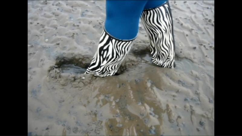 Jana goes in mud flat with zebra rubber boots and washes them in stream