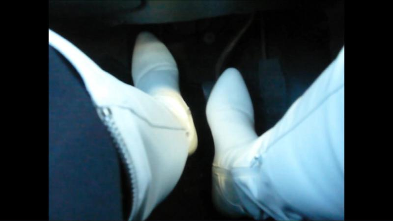 Jana drives the car with her white Graceland over the knee heel boots