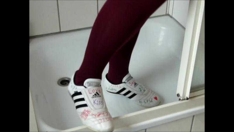 Jana write on squeaks with her Adidas Martial Arts white black and destroy them in shower