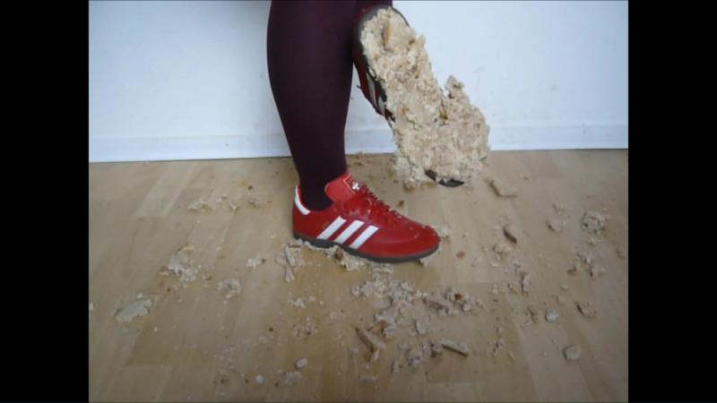 Jana crush bread with her red Adidas Samba sneakers