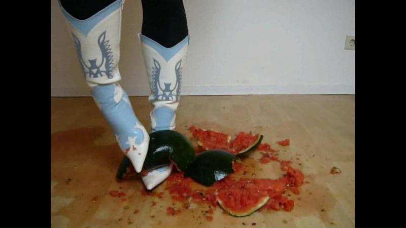 Jana crushes a watermelon with her stiletto cowgirl boots